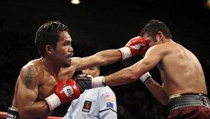 Manny Pacquiao stops Oscar de la Hoya with 8th round TKO...